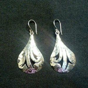 Silver drop earring.